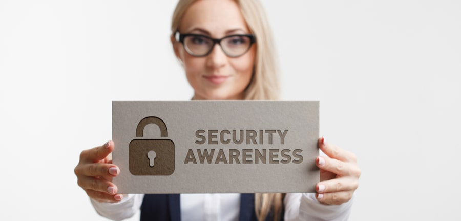 A young girl holding a sign with an inscription Security Awareness depicting the importance of security awareness training for Orlando business owners
