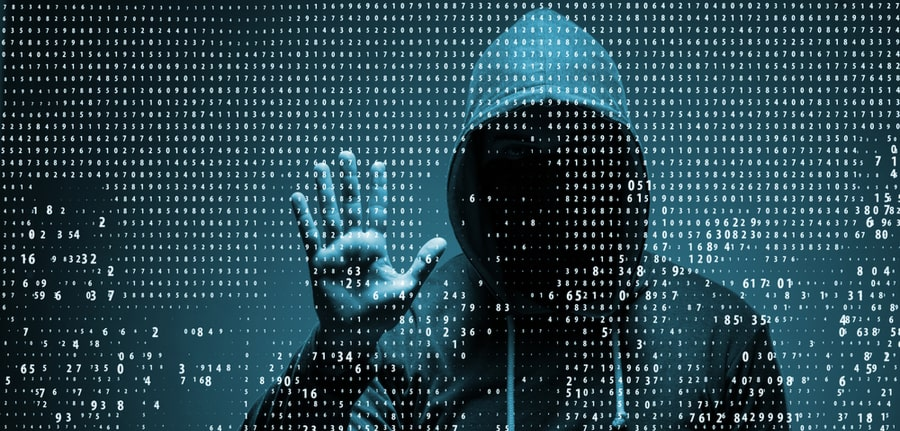 Young hacker in a hoddie depicting a data security concept