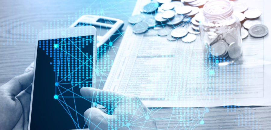 Business technology people are calculating costs online payment and digital cyber security interface, depicting the need to account for Cybersecurity in the budgeting process